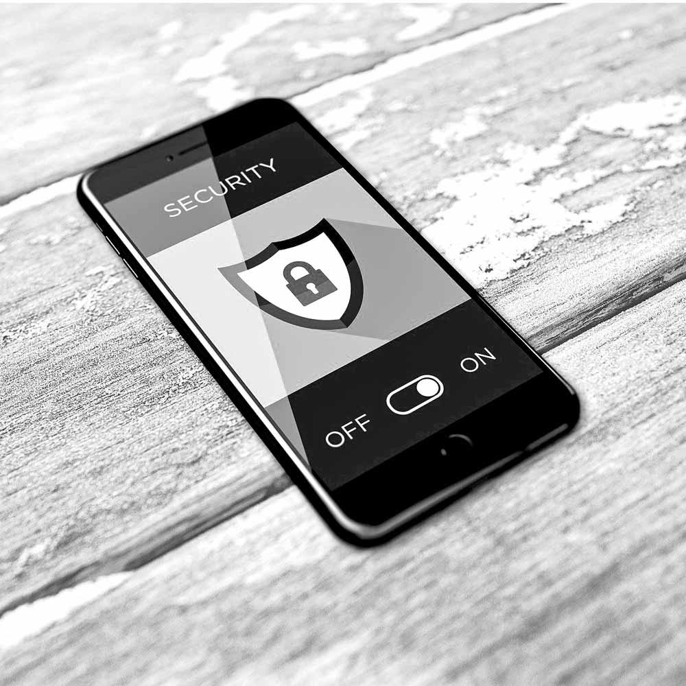 Bild mit Handy mit Schild und Schloss für IT-Sicherheit